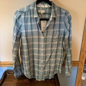 Blue and green flannel. Tags still on. Never worn